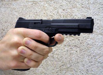 hand holding pistol